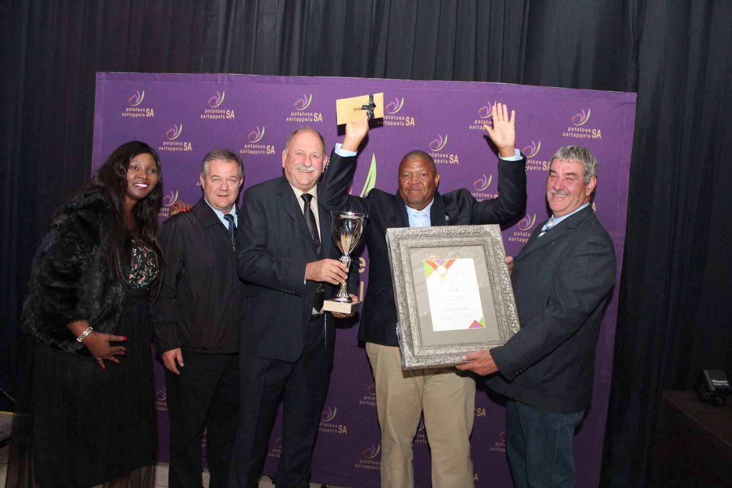 Phophi Raletjana celebrates after being announced as Potatoes South Africa's (PSA) Enterprise Development Farmer of the Year. From the left is Nomvula Xaba (PSA Transformation Manager), Dr. André Jooste (CEO of PSA) JF van der Merwe (Chairperson of PSA), Raletjena and Bernhardt du Toit (the Chairperson of PSA's Transformation Committee).