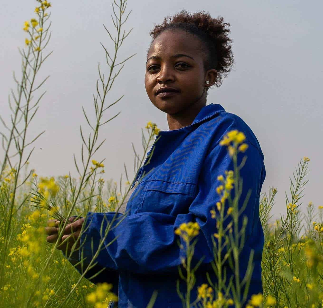 6 September 2018: 27-year-old Dineo Boshomane standing in a field of some of the Chinese spinach which she grows on her one-hectare farm in Northern Farm, Diepsloot. | Photo: Ihsaan Haffejee, New Frame.