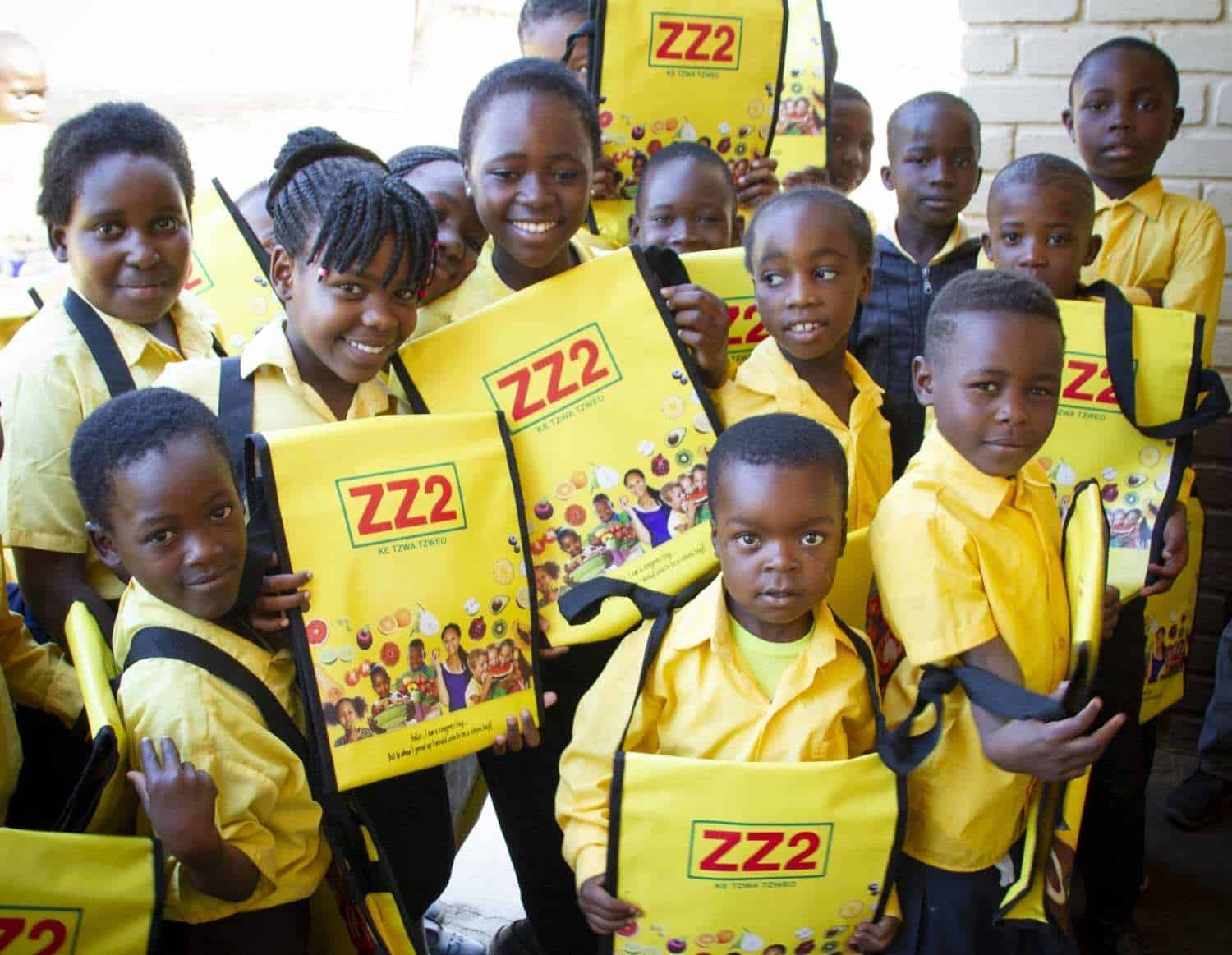Learners from ZZ2 Primary School in Mooketsi, Limpopo boasting with their brand-new school bags made from recycled billboards.