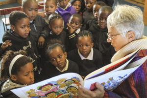 Visiting literacy specialist Anne Hill with Grade R learners, helping them to observe, interpret and verbalise what they hear in storytelling and see in books. Photo: Chris Marais