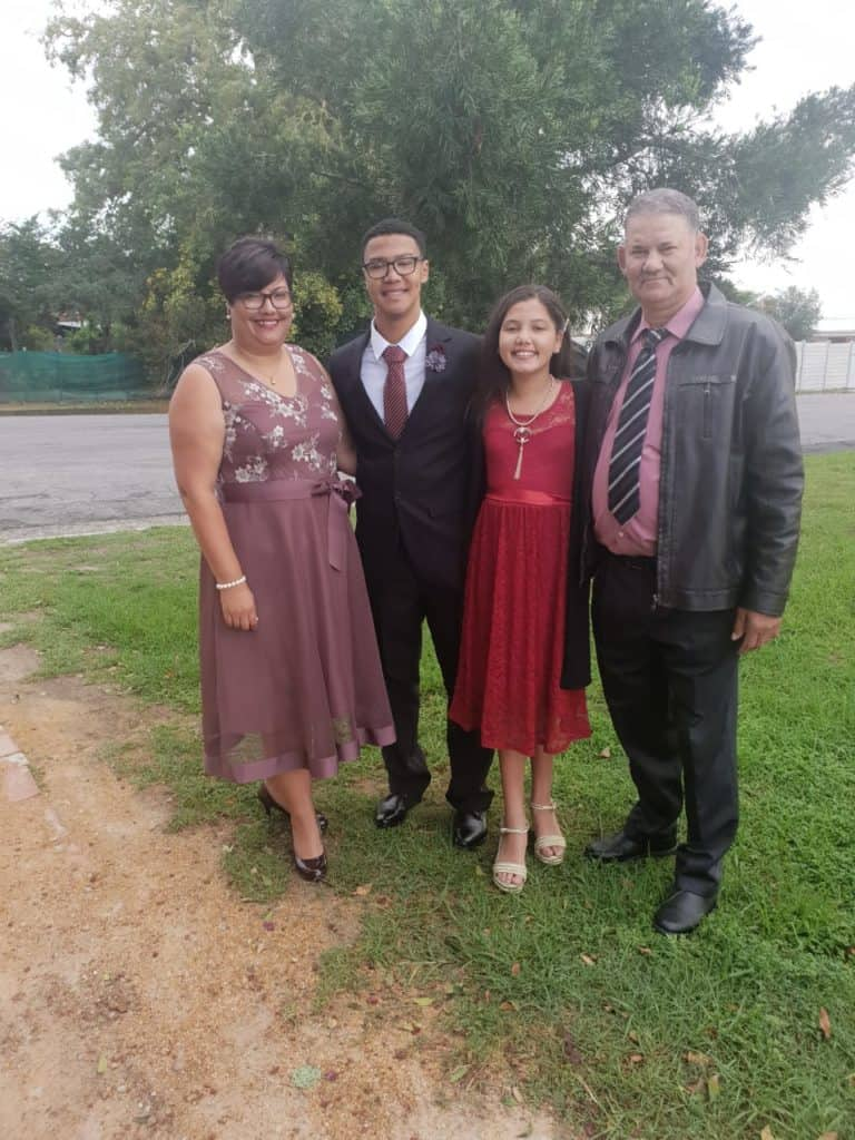 Preline Swart with her husband, Ralph and their children, Charmile and Hope.