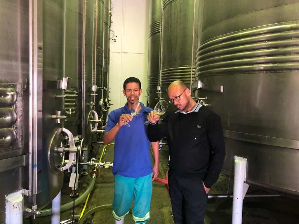 Bothman and Desmond Matthys, cellar assistant at De Wetshof Estate tasting the 2019 Limestone Hill Chardonnay vintage.