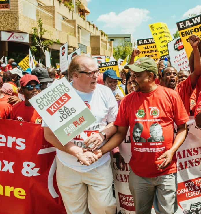Francois Baird and Katishi Masemola of the Food and Allied Workers Union march for jobs.