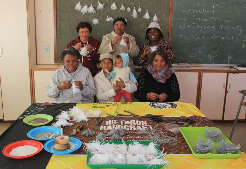 Some of Rietbron angelmakers in their 'office' at Bronville Primary School. Back from left to right: Brenda Rex, Anna Solomon and Ronel Skaarnek. In front, Sara Steenkamp, Juliana Steenkamp with her baby Jaylene, and Elsie Theron. Photo: Chris Marais
