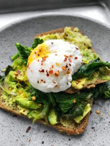 Mashed Avo & Corn with Poached Egg and Spinach sandwich.