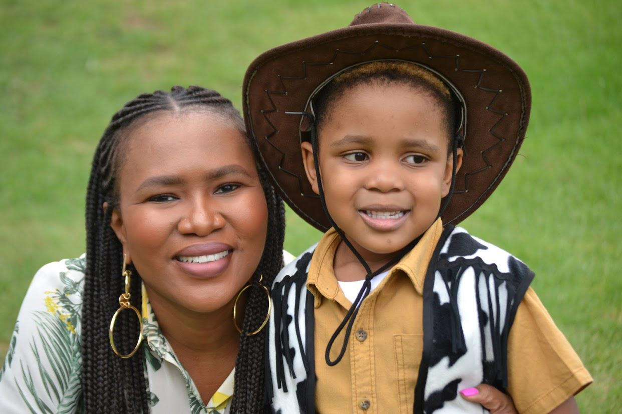 Thooe and her 5-year old son enjoy gardening in her backyard.