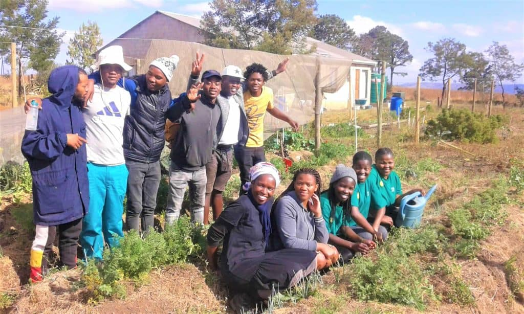 Khaya Mposula (Front left) with some of the youngsters in the farming programme.