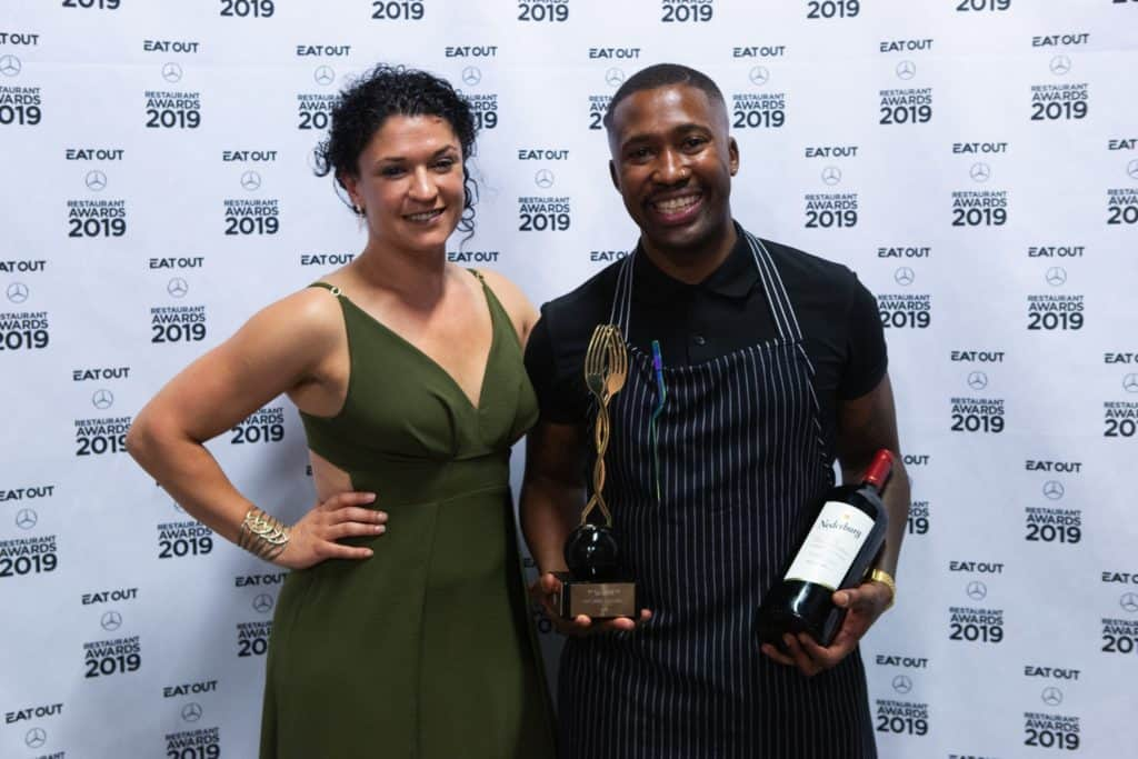Marguerite Beukes of Nederburg with Eat Out Nederburg Rising Star Award winner Katlego Mlambo