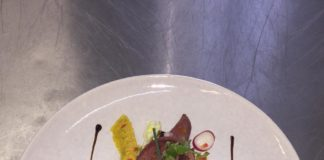 Chef Sibu Nyembe's braised ox tongue salad on a bed of summer salad.
