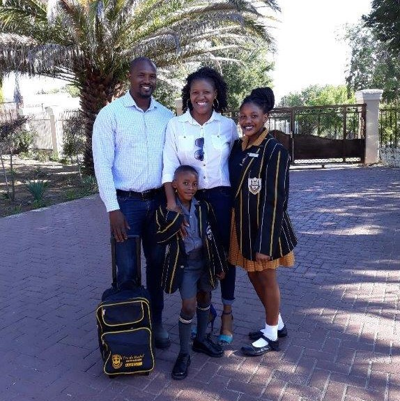 Pictured: Portia Lepesa with her husband (Lwandle), Daughter (Thandeka) and son (Lungile).