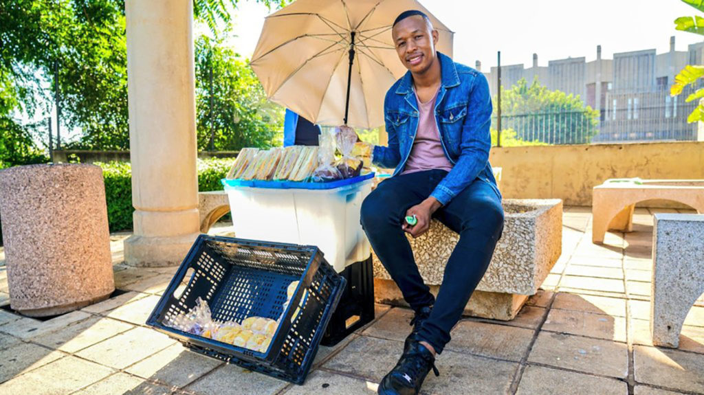 Social grant: Itumeleng Lekomanyane is the owner of Sandwich Nton Nton, a street hustle he started with only R800. Today, he earns an income of close to R20 000 per month. Photo: Supplied/Food For Mzansi