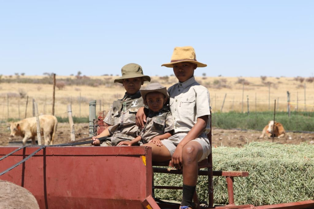 Kutlo Mongale, (left) chose to spend his eight birthday on his gradnfather's farm with his two cousins.