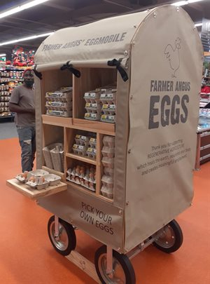 Checkers shoppers can experience a world-first by picking their eggs out of Eggmobiles stationed in store, that McIntosh designed and built in collaboration with 3 Thirds. Photo: Supplied