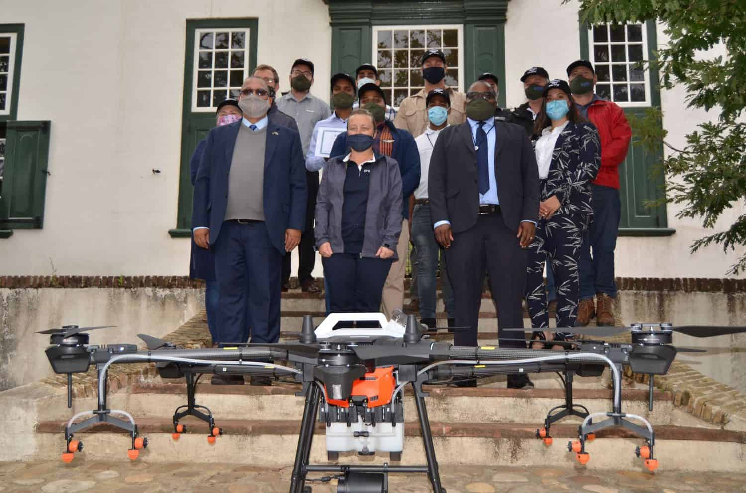 Western Cape minister of agriculture, Dr Ivan Meyer, with Dr Mogale Sebopetsa and the group of recently qualified drone pilots. Photo: Supplied
