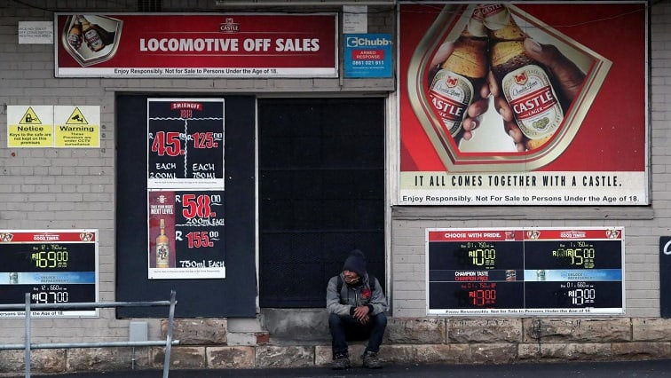 A bystander sits outside a closed liquor store during a nationwide lockdown due to the outbreak of the coronavirus disease. Photo: Reuters