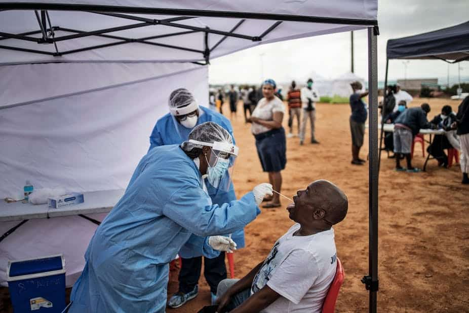 A healthcare worker collecting a swab for a covid-19 test from a community member. Photo: AFP via Getty Images