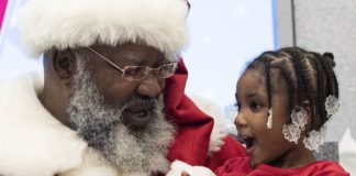 Santa Clause brings Christmas cheer to a young Food For Mzansi reader. Photo: Supplied