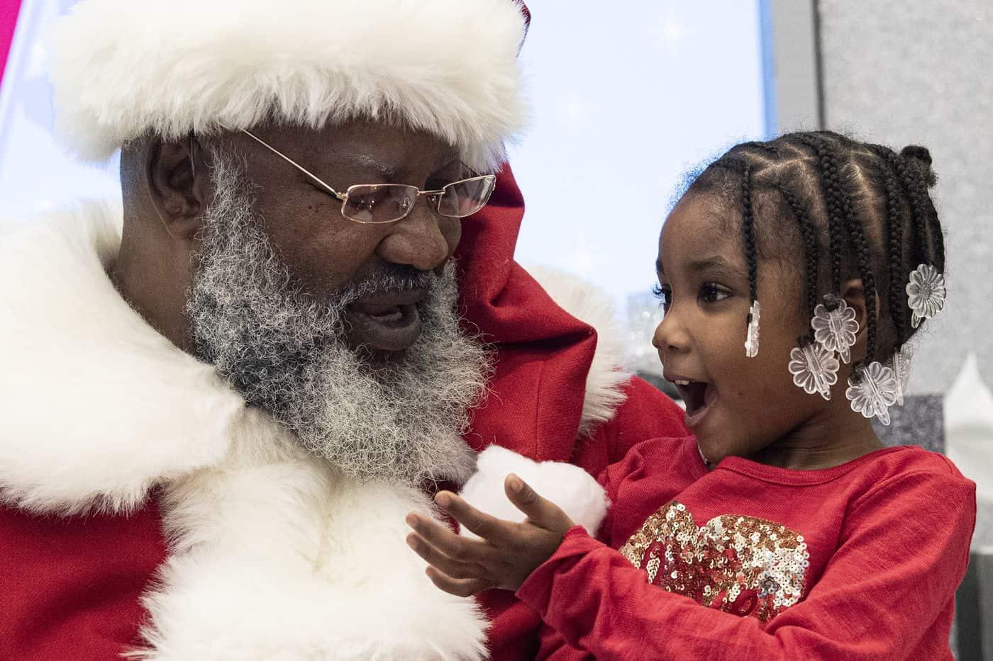 Santa Clause brings Christmas cheer to a young Food For Mzansi reader. Photo: Supplied