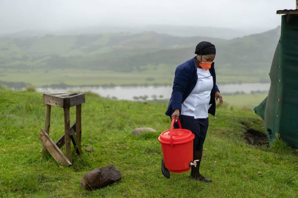 Nurse Nonhlanhla Shozi packs away the hand-washing station after a quiet day at the Bulungula Health Point in rural Eastern Cape. The nearest government clinic is a three-hour walk away.