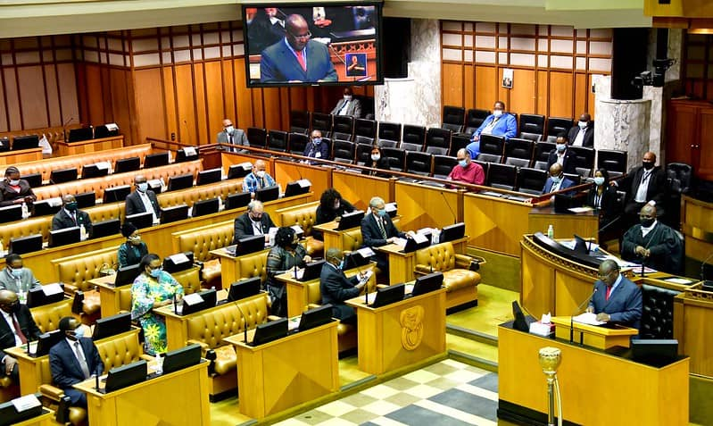 Members of the National Assembly listen attentively to finance minister Tito Mboweni's 2021 budget speech. Photo: GCIS/Flickr