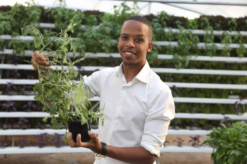 Khaya Maloney, vertical rooftop farmer in Johannesburg. Photo: Supplied