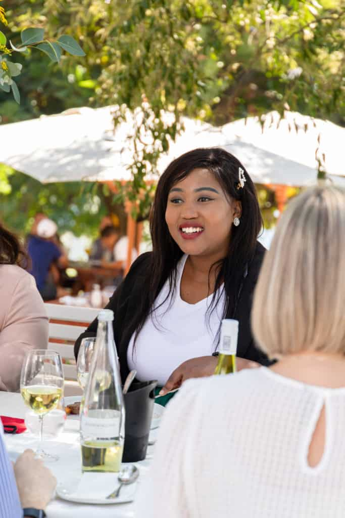 Food For Mzansi journalist Sinesipho Tom enjoying lunch following the Sinelizwi ceremony at the Rhebokskloof wine estate in Paarl in the Western Cape. Photo: Food For Mzansi