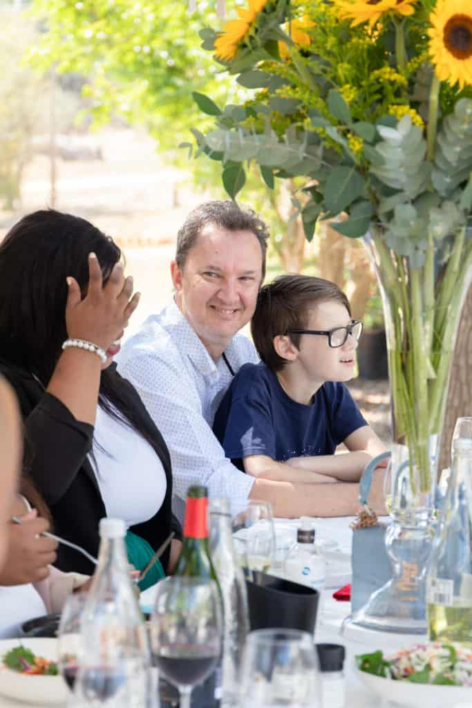 Food For Mzansi co-founder Kobus Louwrens pictured with his son, Jan, during the Sinelizwi awards luncheon. The 11-year-old Jan played an instrumental role in the publication's Thandi and Captain Stay Safe Covid-19 campaign. Photo: Food For Mzansi
