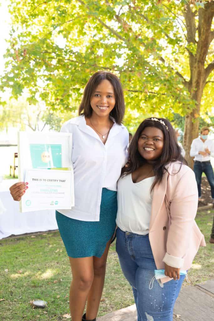 Rising farming star Gugulethu Mahlangu celebrating her win as Gauteng's top Sinelizwi journalist with Food For Mzansi journalist Noluthando Ngcakani. Photo: Food For Mzansi