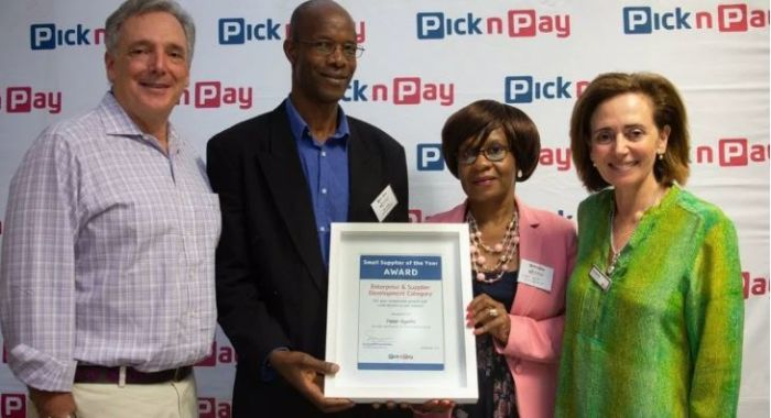 Mushroom farmer Peter Nyathi has scooped a number of awards. Here he is receiving the 2019 Pick n Pay Small Supplier of the Year award. Photo: Supplied/Food For Mzansi