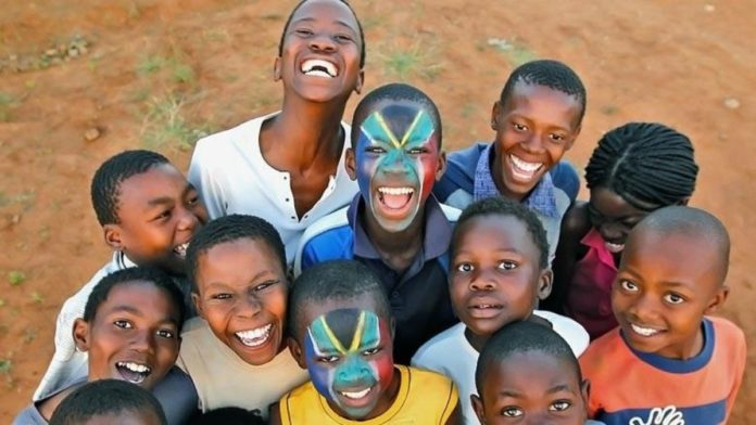 Mandela Day: An earlier picture of the brothers Thabana and Tsholofelo Matlhonoko with their faces painted in the South African flag, posing with their friends. Photo: Marc Aspland/The Times