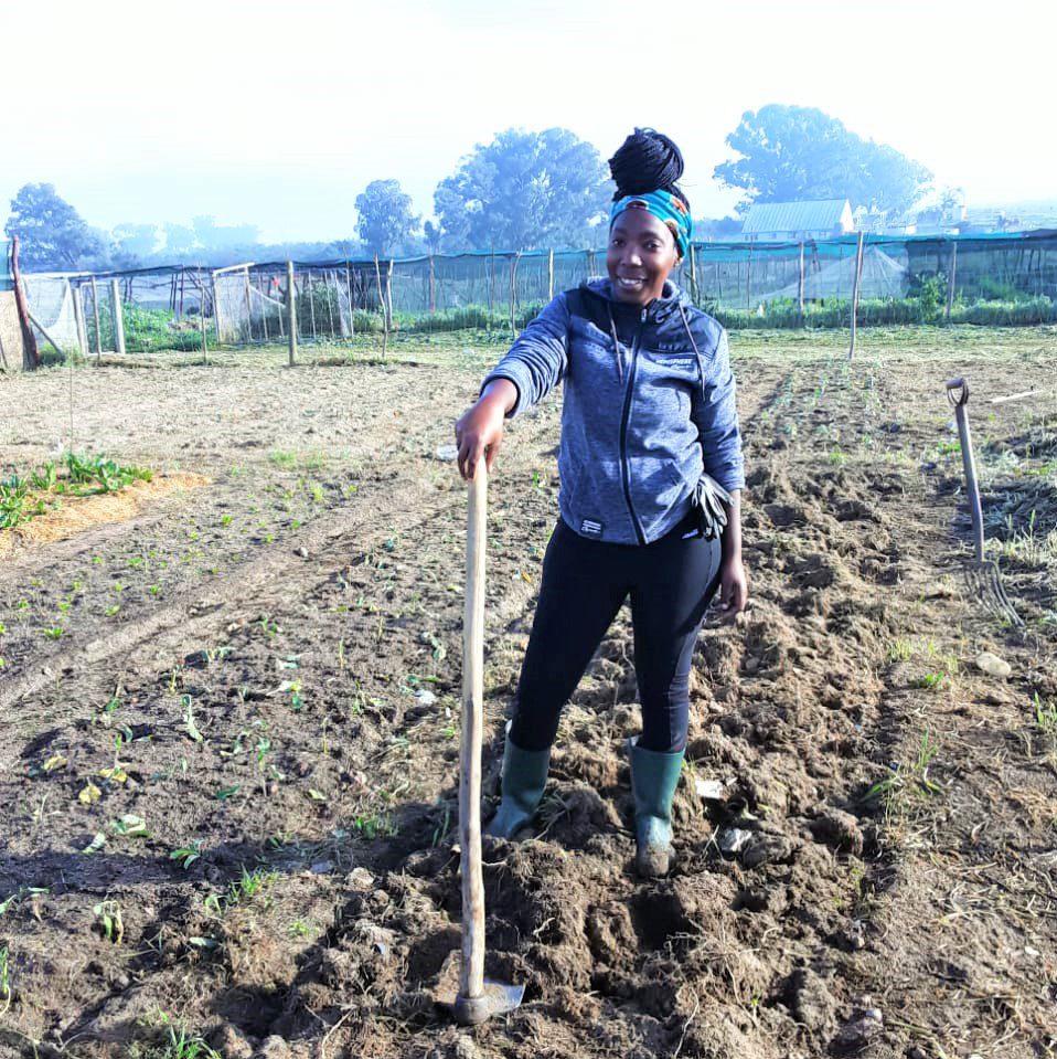 Sinethemba Botha, busy tilling the land of her veggie garden. Photo: Supplied/Sinethemba Botha