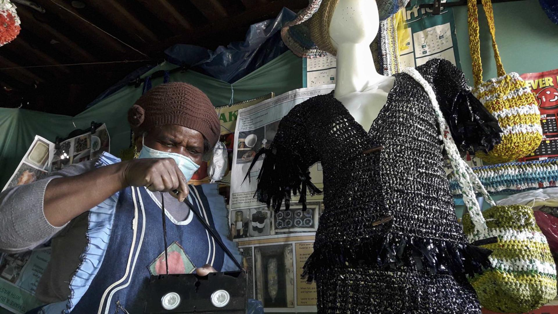 Recycling: Thenjiwe Jacobs, founder of the Noziqamo recycling project in Motherwell, Gqeberha, with an outfit she made using old VCR tapes. Photo: Photographs by Sibongile Portia Jonas