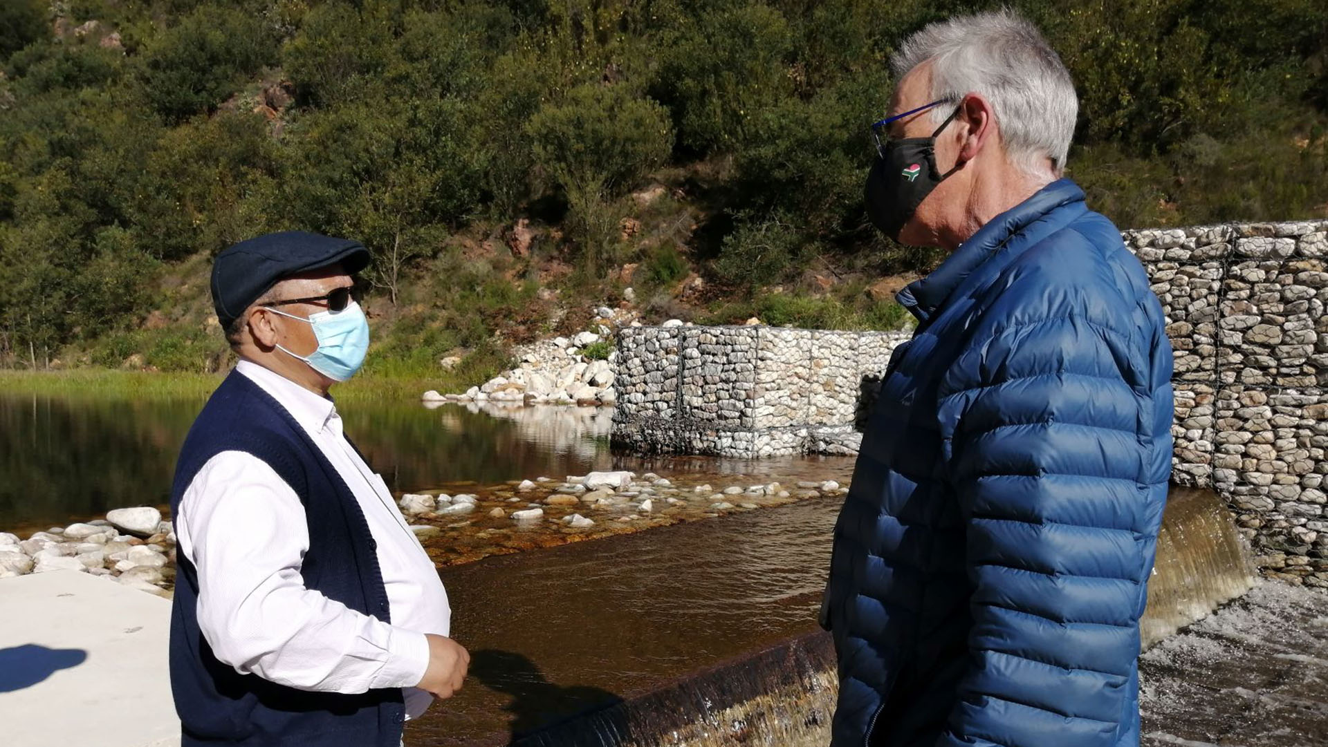 Western Cape agriculture MEC Dr Ivan Meyer and Hans King, designing engineer, with the Meul weir in the background. Photo: Supplied/Food For Mzansi